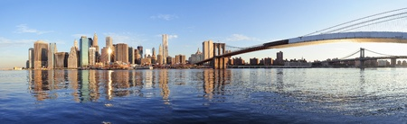 east river: Brooklyn Bridge and Manhattan Bridge with lower Manhattan skyline panorama over East River in New York City