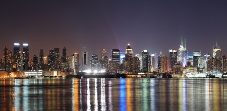 midtown: New York City Manhattan midtown skyline at night with lights reflection over Hudson River viewed from New Jersey Weehawken waterfront. Stock Photo