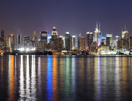 weehawken: New York City Manhattan midtown skyline at night with lights reflection over Hudson River viewed from New Jersey Weehawken waterfront. Stock Photo