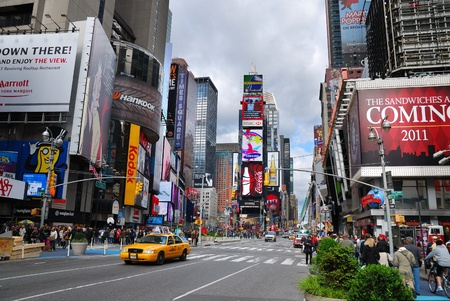 time square: NEW YORK CITY - SEP 5: Times Square, featured with Broadway Theaters and LED signs, is a symbol of New York City and the United States, September 5, 2009 in Manhattan, New York City.