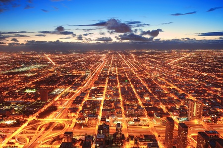 city lights: Chicago downtown aerial panorama view at dusk with skyscrapers and city skyline.