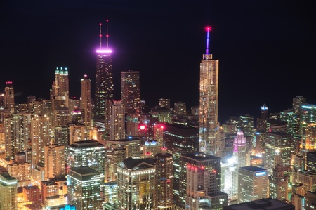 hancock building: Chicago downtown aerial view at night with skyscrapers and city skyline at Michigan lakefront.  Stock Photo