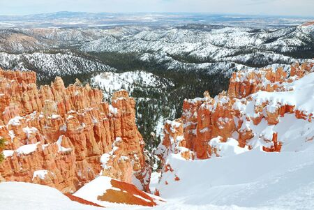 bryce canyon: Bryce canyon panorama with snow in Winter with red rocks and blue sky.  Stock Photo