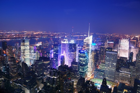 new york city times square: New York City Manhattan Times Square skyline aerial view panorama at night with skyscrapers and street.