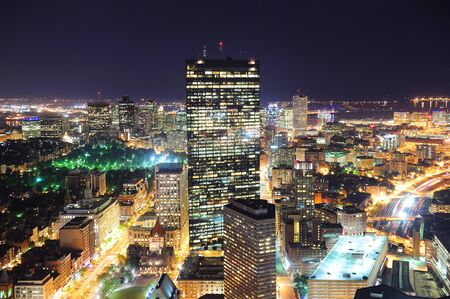 boston skyline: Boston aerial view with skyscrapers at night with city skyline illuminated.