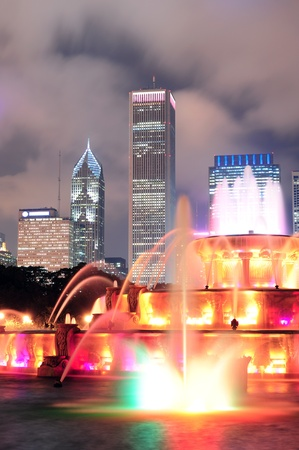 buckingham: Chicago skyline with skyscrapers and Buckingham fountain in Grant Park at night lit by colorful lights. Stock Photo