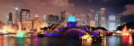 Chicago skyline panorama with skyscrapers and Buckingham fountain in Grant Park at night lit by colorful lights. Stock Photo
