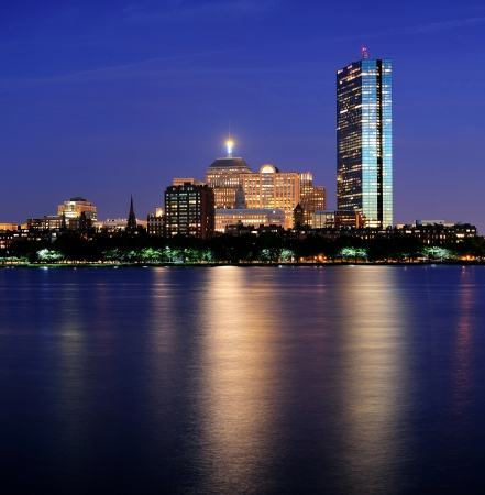 Boston Charles River at dusk with urban city skyline and light reflection Stock Photo