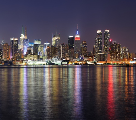 new york night: New York City Manhattan midtown skyline at night with lights reflection over Hudson River viewed from New Jersey Weehawken waterfront. Stock Photo