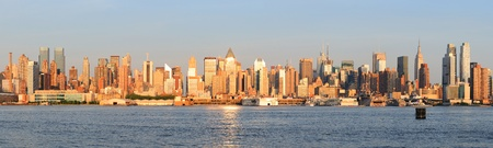 New York City Manhattan midtown skyline panorama at sunset. Stock Photo
