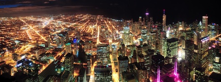 hancock building: Chicago downtown aerial panorama view at night with skyscrapers and city skyline at Michigan lakefront.  Stock Photo