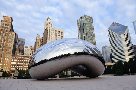 anish: CHICAGO, IL - Oct 6: Cloud Gate and Chicago skyline on October 6, 2011 in Chicago, Illinois. Cloud Gate is the artwork of Anish Kapoor as the famous landmark of Chicago in Millennium Park.