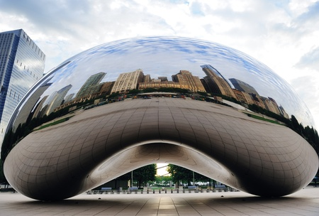 CHICAGO, IL - Oct 6: Cloud Gate and Chicago skyline on October 6, 2011 in Chicago, Illinois. Cloud Gate is the artwork of Anish Kapoor as the famous landmark of Chicago in Millennium Park. Stock Photo - 10958143