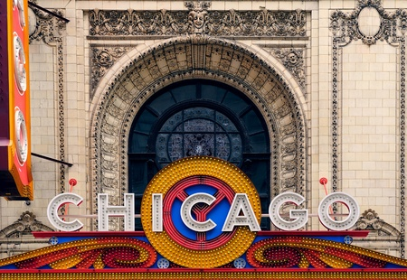 appears: CHICAGO, IL - Oct 6: Chicago Theatre and street view on October 6, 2011 in Chicago, Illinois. The iconic Chicago Theatre marquee appears in film, television, artwork, and photography as city landmark.