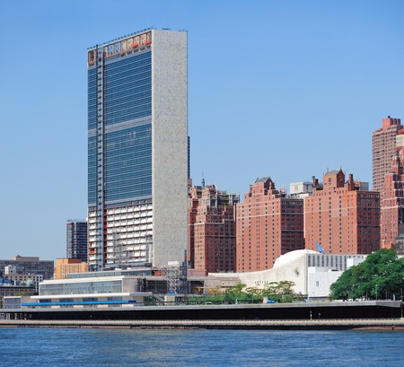 NEW YORK CITY, NY - JUL 10: UN complex over East River on July 10, 2011 in New York City. The United Nations complex was designed by an international team of 11 architects led by Wallace K. Harrison.