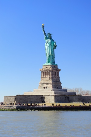 Statue of Liberty on Liberty Island closeup with blue sky in New York City Manhattan