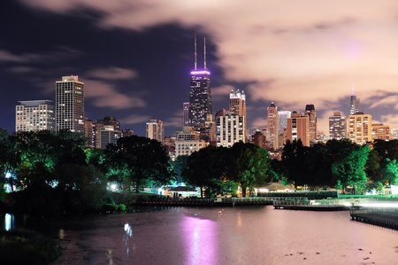 Chicago city urban skyscraper at night over lake viewed from Lincoln Park.