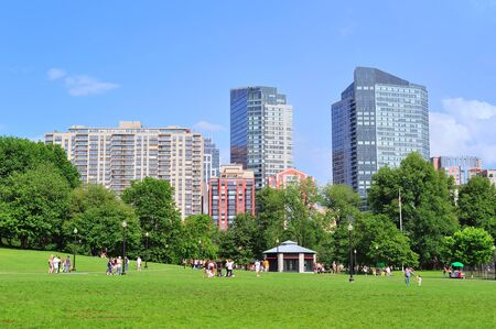 Boston Common public garden in downtown with urban architecture.