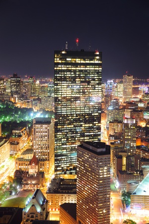 Boston aerial view with skyscrapers at night with city skyline illuminated.
