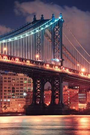 Manhattan Bridge closeup over East River at night in New York City Manhattan with lights and reflections. Stock Photo - 11565723