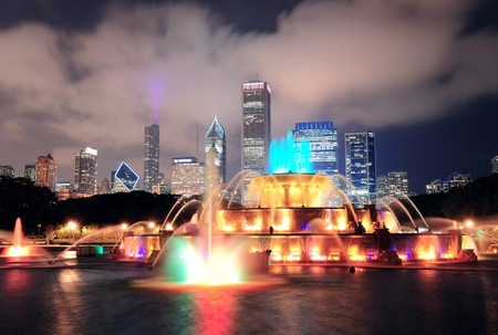 Chicago skyline with skyscrapers and Buckingham fountain in Grant Park at night lit by colorful lights. Stock Photo - 11565794