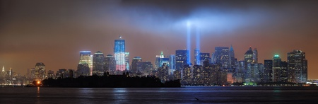 wtc: New York City Manhattan downtown skyline at night from Liberty Park with light beams in memory of September 11 viewed from New Jersey waterfront.