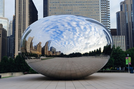 CHICAGO, IL - Oct 6: Cloud Gate and Chicago skyline on October 6, 2011 in Chicago, Illinois. Cloud Gate is the artwork of Anish Kapoor as the famous landmark of Chicago in Millennium Park.