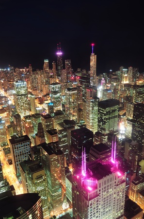 Chicago downtown aerial view at night with skyscrapers and city skyline at Michigan lakefront.  photo