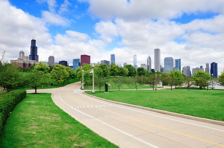 Chicago skyline with trees and law with cloudy blue sky. photo