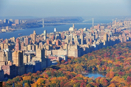 central park: New York City skyscrapers in midtown Manhattan aerial panorama view in the day with Central Park and colorful foliage in Autumn.