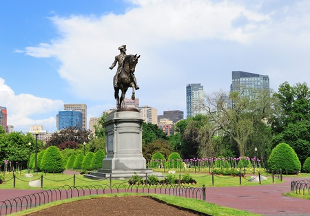 george washington: George Washington statue as the famous landmark in Boston Common Park with city skyline and skyscrapers.