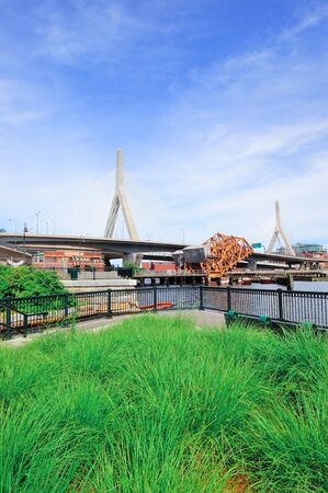 Boston Leonard P. Zakim Bunker Hill Memorial Bridge with blue sky in park as the famous land mark. photo