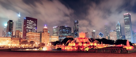 city park skyline: Chicago skyline panorama with skyscrapers and Buckingham fountain in Grant Park at night lit by colorful lights. Stock Photo