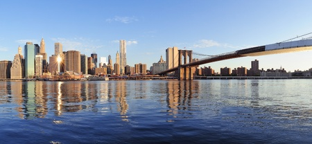 brooklyn bridge: Brooklyn Bridge with lower Manhattan skyline panorama in the morning with cloud and river reflection over East River in New York City