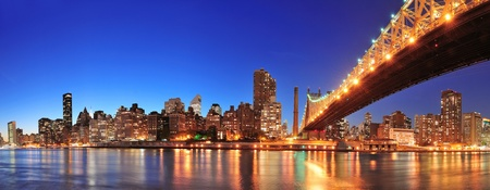 Queensboro Bridge over New York City East River at sunset with river reflections and midtown Manhattan skyline illuminated. Stock Photo - 11999967