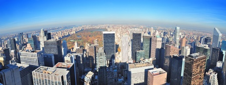 New York City skyscrapers in midtown Manhattan aerial panorama view in the day with Central Park and colorful foliage in Autumn. photo