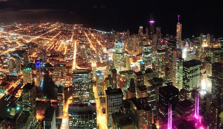 city lights: Chicago downtown aerial panorama view at night with skyscrapers and city skyline at Michigan lakefront.  Stock Photo