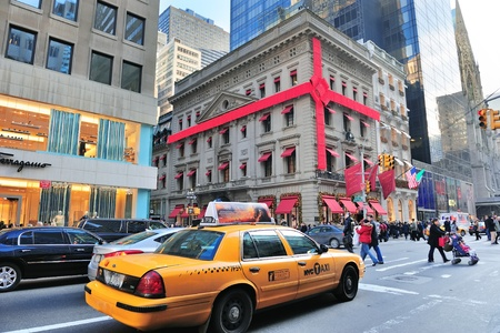 yellow cab: NEW YORK CITY, NY - DEC 30: Busy traffic on street on December 30, 2011 in New York City. Fifth Avenue has the worlds most expensive retail spaces as the symbol of wealthy New York. Editorial