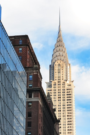 NEW YORK CITY, NY, USA - DEC 30: Chrysler Building in the day with street on December 30, 2011, New York City. It was designed by architect William Van Alena as Art Deco architecture in US.