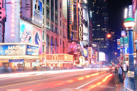 42nd: NEW YORK CITY, NY - DEC 12: 42nd Street with traffic and commercials on December  12, 2011 in New York City. 42nd Street is a major crosstown street known for its theaters and landmark architectures.