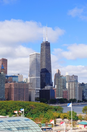 Chicago city urban skyline with skyscrapers over Lake Michigan with cloudy blue sky. Stock Photo - 12571484