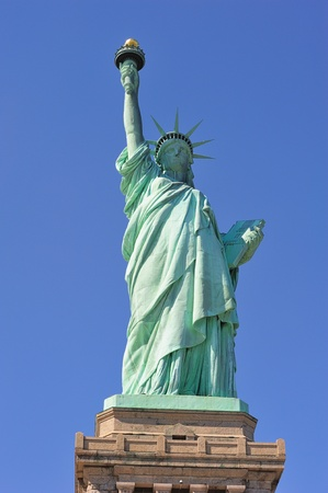 Statue of Liberty closeup with blue sky in New York City Manhattan photo