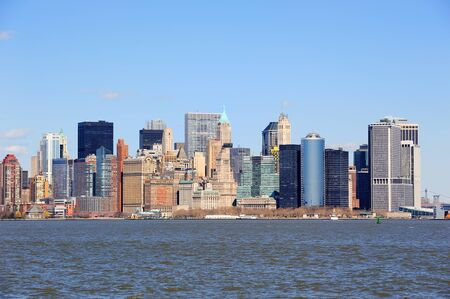 Urban skyscrapers of New York City Manhattan downtown over river. photo