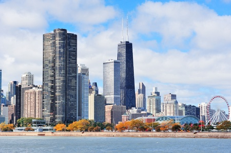 hancock building: Chicago city urban skyline with skyscrapers over Lake Michigan with cloudy blue sky. Stock Photo