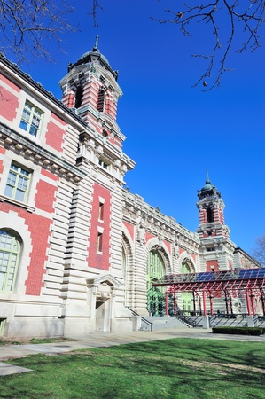 New York City Ellis Island Great Hall with blue clear sky photo