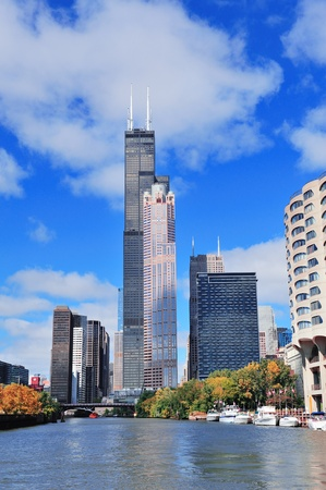 the sears tower: Chicago city downtown urban skyline with skyscrapers over Lake Michigan with cloudy blue sky.