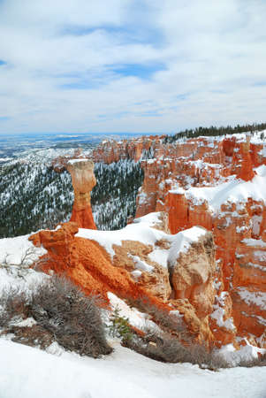 Bryce canyon panorama with snow in Winter with red rocks and blue sky.  photo