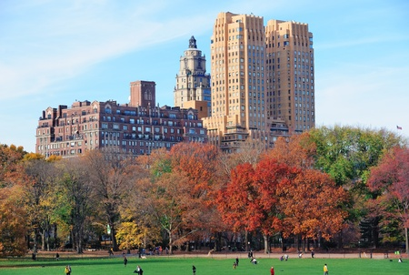 Central Park in New York City Manhattan midtown in Autumn with colorful foliage and historical buildings. photo