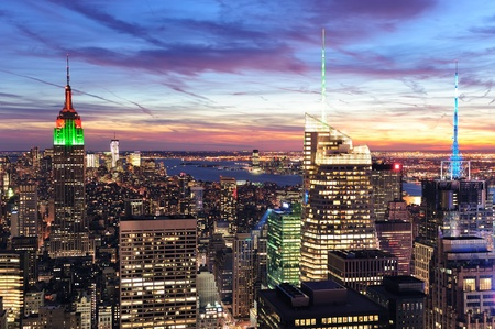 empire state building: New York City skyline with urban skyscrapers at sunset.
