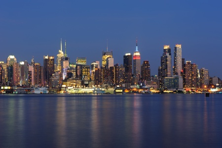 weehawken: New York City Manhattan midtown skyline panorama at dusk with historical landmark skyscrapers over Hudson River viewed from New Jersey Weehawken waterfront.